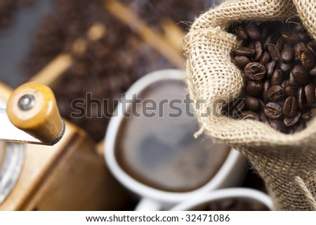 Cup of coffee with sack of coffee bean
