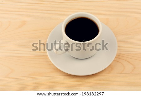 Cup of Coffee with Saucer on Pine Wooden Table