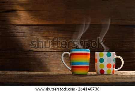 Cup of coffee with smoke on old wooden background,This photo is available without smoke - stock photo