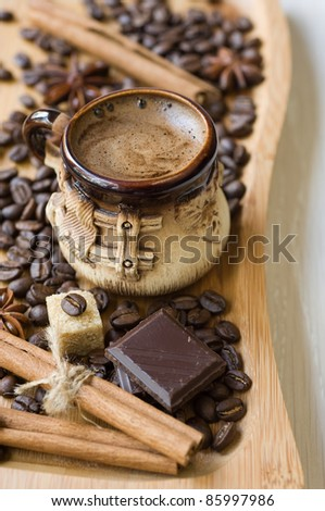cup of coffee with spices and chocolate - stock photo