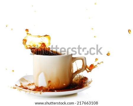 Cup of coffee with splashes, isolated on white - stock photo