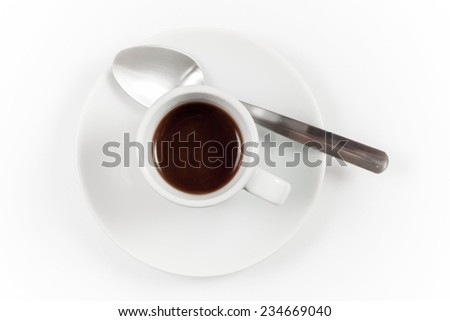 Cup of coffee with spoon isolated on white background, top view - stock photo