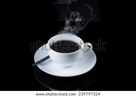 Cup of coffee with steam on black background
