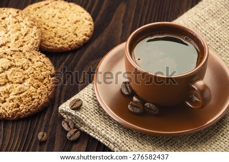 Cup of coffee with sweat cookies