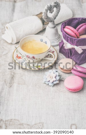 Cup of coffee with sweets and decorations vertical