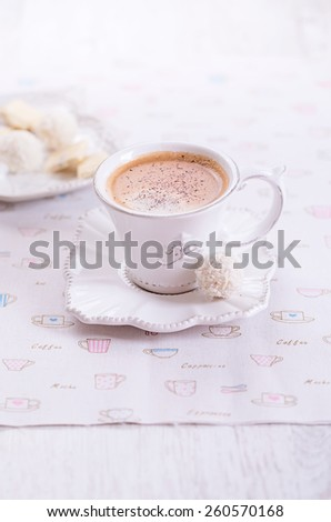 Cup of coffee with  sweets on light fabric - stock photo