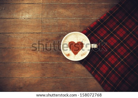 Cup of coffee with tartan - stock photo