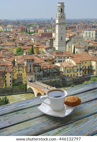 Cup of coffee with Verona view