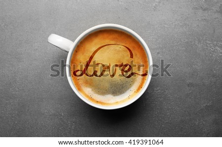 Cup of coffee with word Love, top view - stock photo