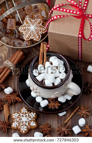 Cup of creamy hot chocolate with melted marshmallows and gingerbread cookies  for christmas holiday