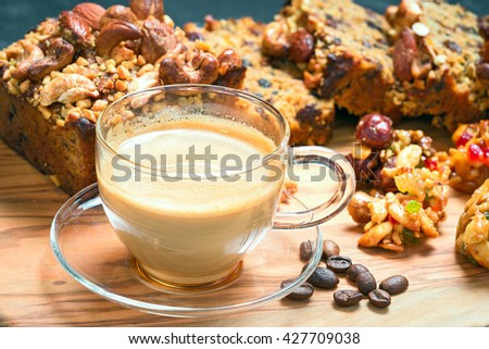 cup of delicious coffee and walnut cake with cookies - stock photo