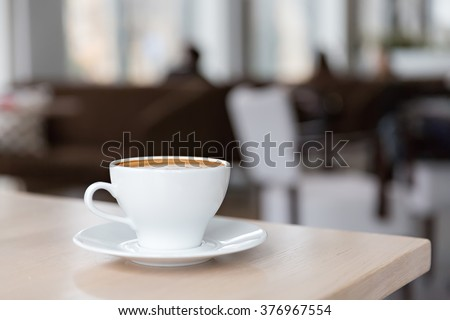 cup of delicious coffee on the table
