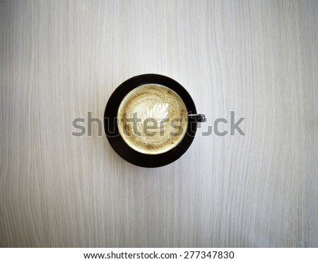 Cup of double shot cappuccino shot from above on a table at a coffee shop - stock photo