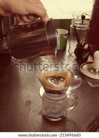 Cup of Dripping fresh hot coffee, vintage color - stock photo