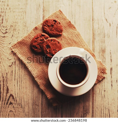 Cup of espresso and biscotti. Photo toned style Instagram filters. - stock photo