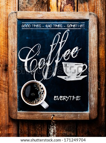 Cup of espresso coffee on a catchy sign saying - Good times, Bad times, Sometimes - Coffee Everytime - on an old school slate in a rustic coffee house or cafeteria - stock photo