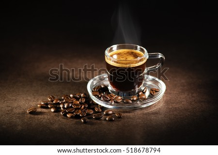 Cup of espresso coffee on dark background.