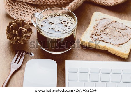 Cup of espresso coffee with working technology lifestyle. Photo in vintage color tone style. - stock photo