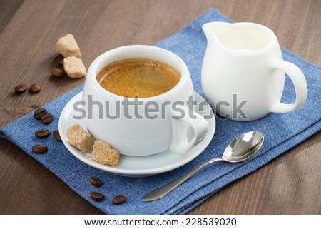 cup of espresso, sugar and jug of milk, horizontal - stock photo