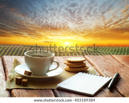 Cup of evening coffee on a wooden table - stock photo