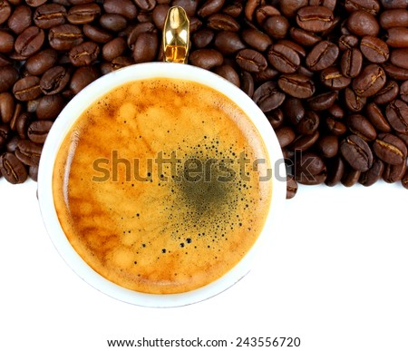 Cup of fragrant and delicious coffee and coffee beans - stock photo