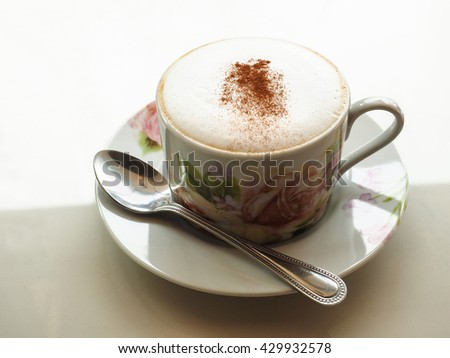 Cup of fresh cappuccino with cocoa powder - stock photo
