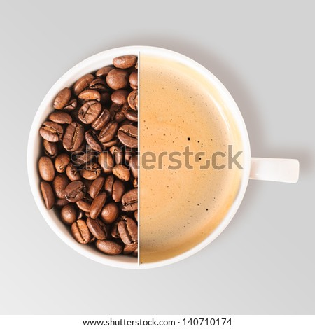 cup of fresh coffee and beans on table, view from above - stock photo