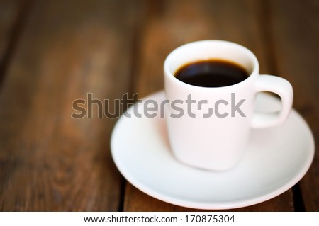 Cup of fresh coffee on rustic wooden background - stock photo