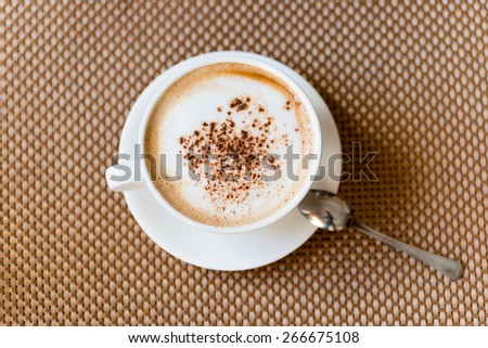 cup of fresh espresso on table, view from above - stock photo