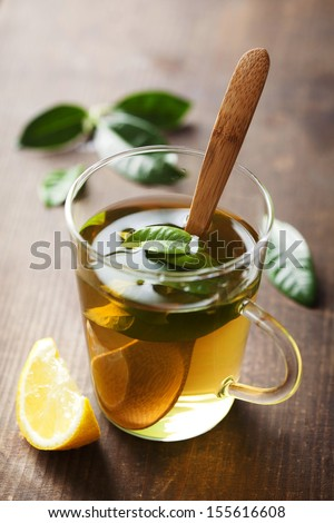cup of fresh tea, made with fresh leaves - stock photo