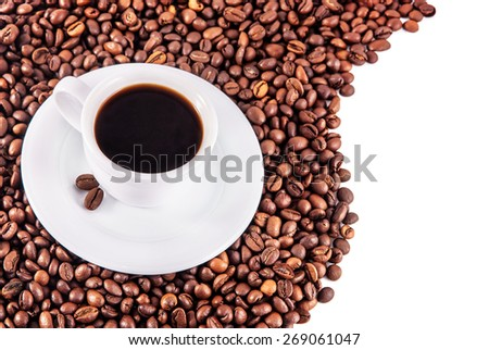 Cup of genuine black coffee with saucer and beans on a white background