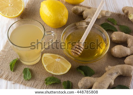 Cup of Ginger tea with lemon and honey. - stock photo