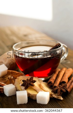 Cup of Ginger tea with lemon and honey on dark  background,