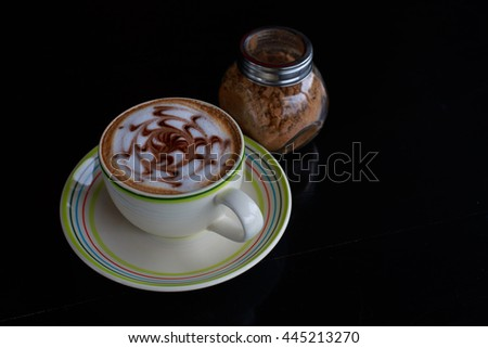 Cup of green coffee, espresso, fresh on the table from the black perspective on light and shadow - stock photo