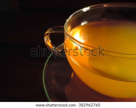 cup of green tea, isolated on black