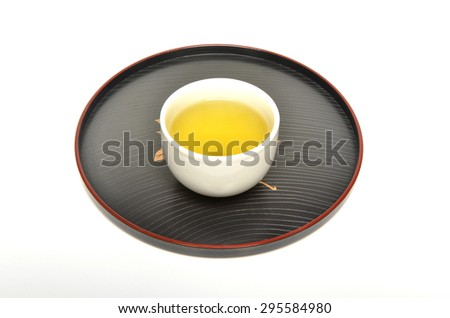 Cup of green tea on a Japanese style tray    - stock photo