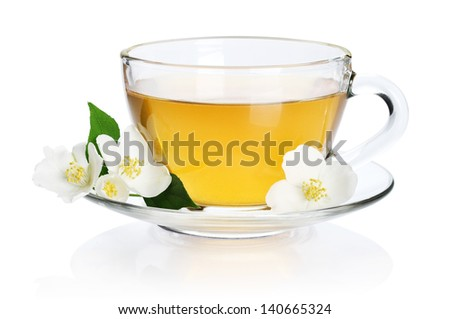 Cup of green tea with jasmine flowers isolated on white background. Clipping path  included. - stock photo