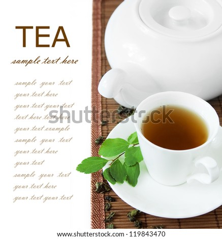 Cup of green tea with kettle and fresh green leaves isolated on white background - stock photo