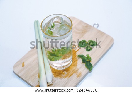 cup of green tea with mint,lemon grass,soft focus - stock photo