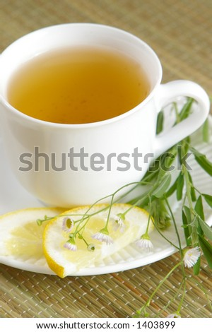Cup of healthy green tea with herbs. - stock photo