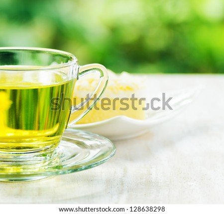 Cup of herbal tea and fresh cake. - stock photo