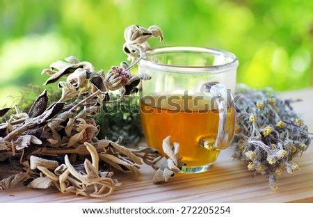 cup of herbal tea on table - stock photo