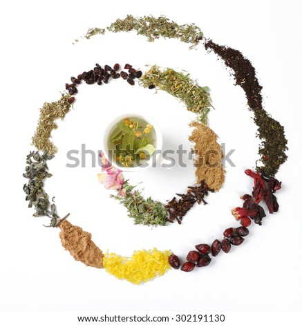 Cup of herbal tea with various kinds of dried herbs isolated on white - stock photo