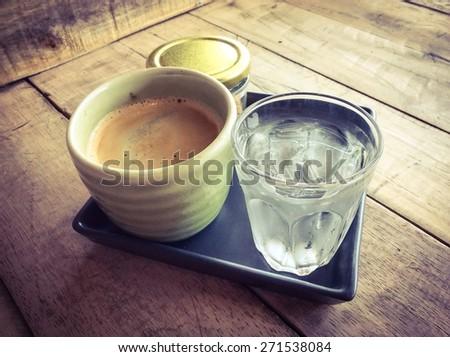 Cup of hot americano black coffee, retro filter effect - stock photo