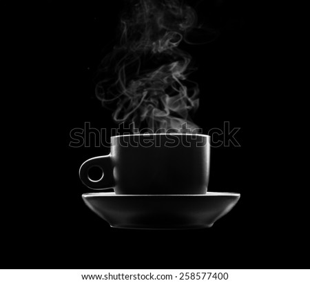 Cup of hot beverage on black - stock photo