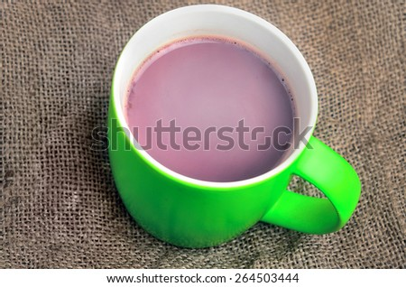 Cup of hot chocolate on table - stock photo