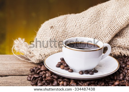Cup of hot coffee against grunge background