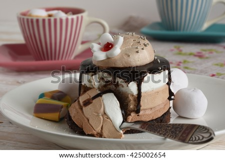 Cup of hot coffee and cake on the table close-up - stock photo