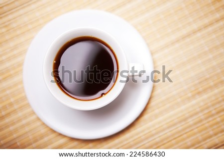 Cup of hot coffee on  - stock photo