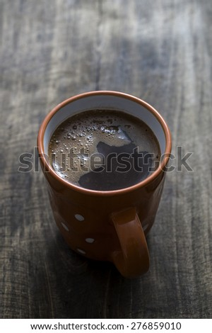 cup of hot coffee on the wooden plank - stock photo
